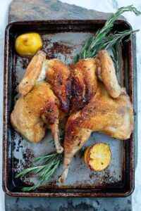 Spatchcocked roasted chicken with rosemary and lemon