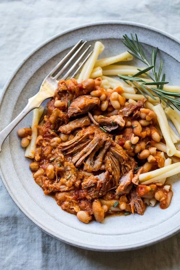 rich, tender slow-cooked pork with rosemary, white beans and pasta