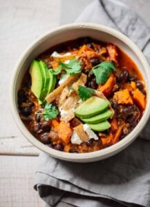 Vegetarian Sweet Potato and Black Bean Chili with Goat Cheese and Avocado