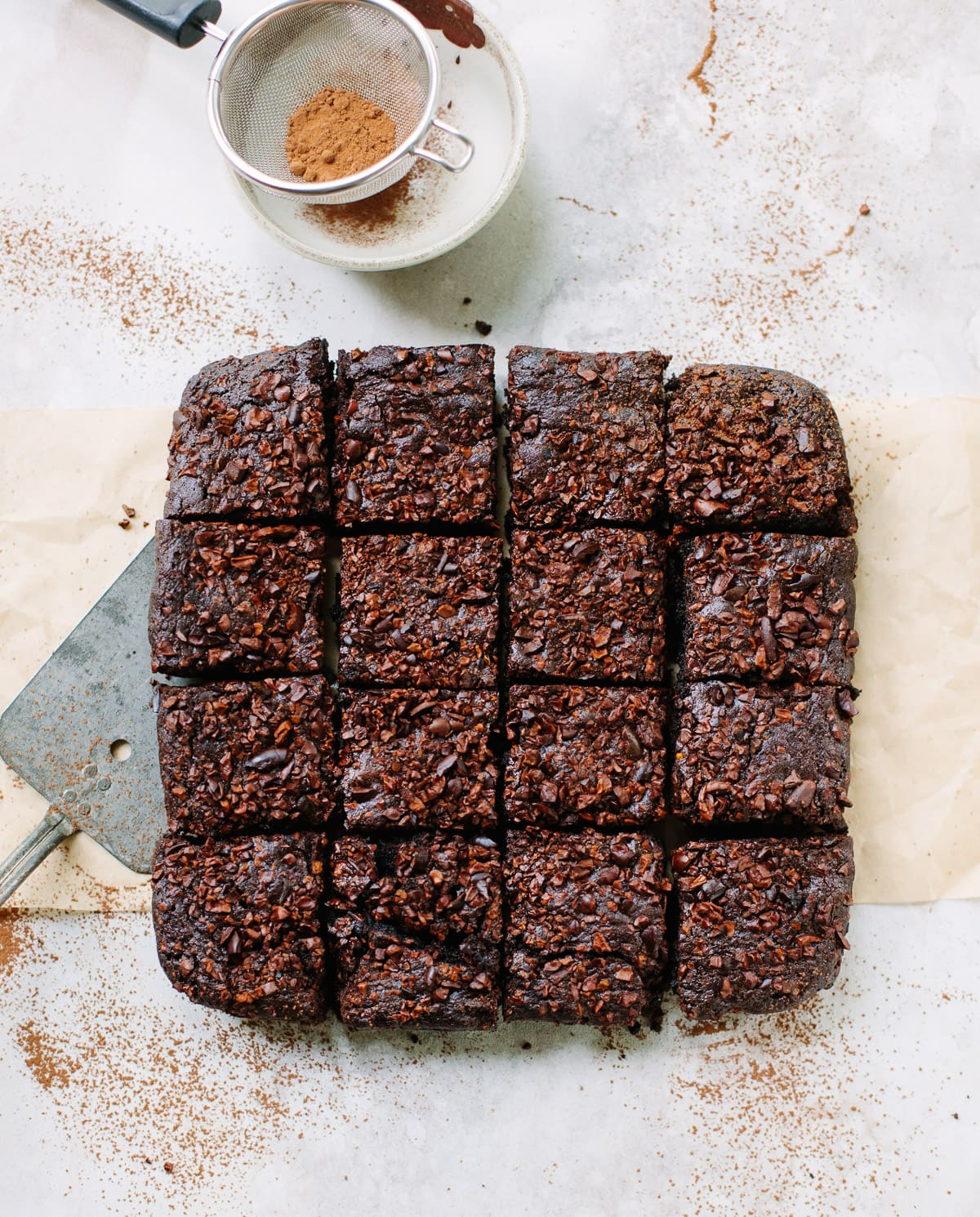 Cocoa Brownies cut into squares, topped with cacao nibs