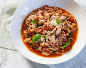 farro and cannellini bean risotto-style with tomatoes, basil and parmean