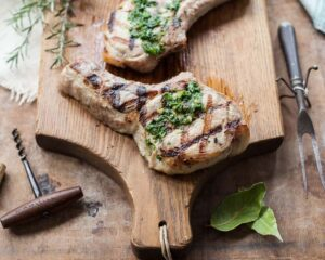 The best juicy brined pork chops, with rosemary and other Tuscan seasonings
