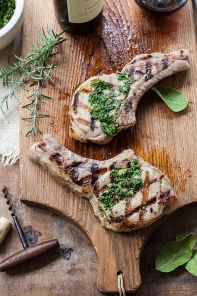 Incredible juicy brined pork chops with Tuscan seasonings - the BEST way to grill pork.