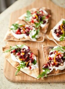 Easy flatbread topped with ricotta and pomegranate relish