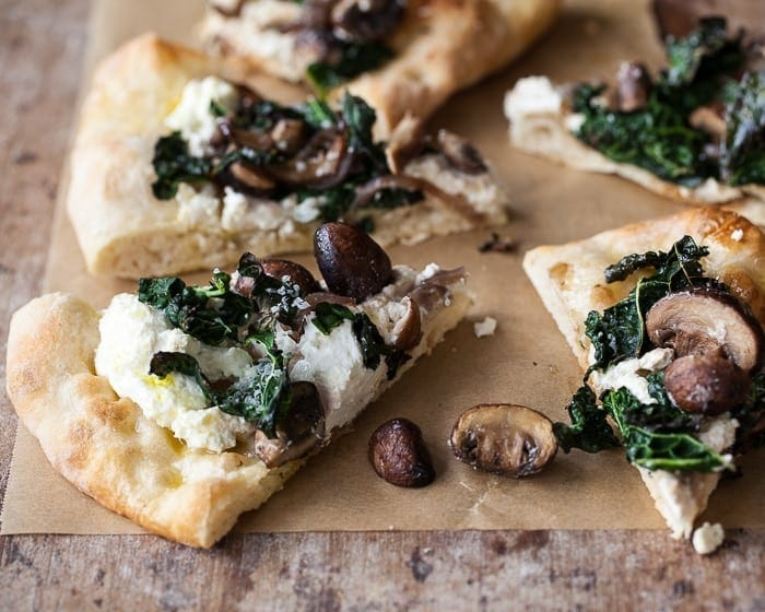 tuscan kale pizza with mushrooms, ricotta and slow-rise dough.