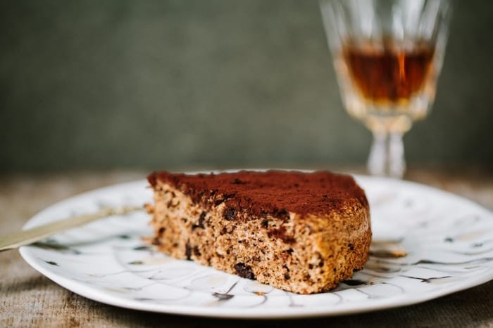 A slice of Venetian chocolate walnut cake dusted with cocoa