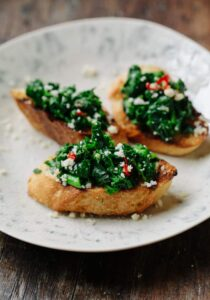 broccoli rabe rapini with garlic, olive oil and chili, served on bruschetta