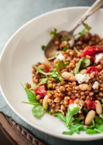farro wheat berry salad with charred tomatoes, arugula and ricotta