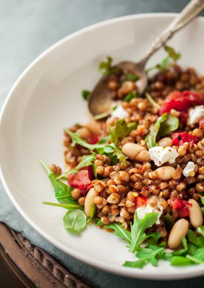 farro wheat berry salad with charred tomatoes, arugula and ricotta