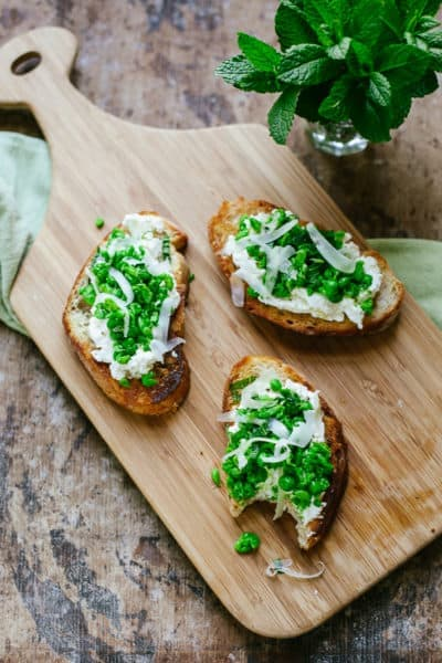 sweet pea bruschetta with ricotta, pecorino cheese and mint
