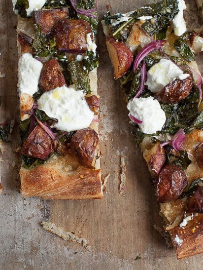 pan pizza with new potatoes, kale and ricotta cheese