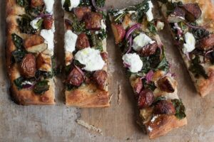 pan pizza with roasted new potatoes , kale and ricotta