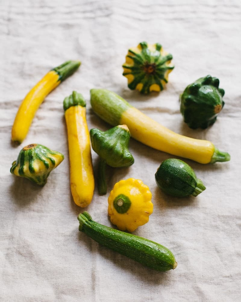Summer Squash, Zucchini and Pattypan on a linen towel