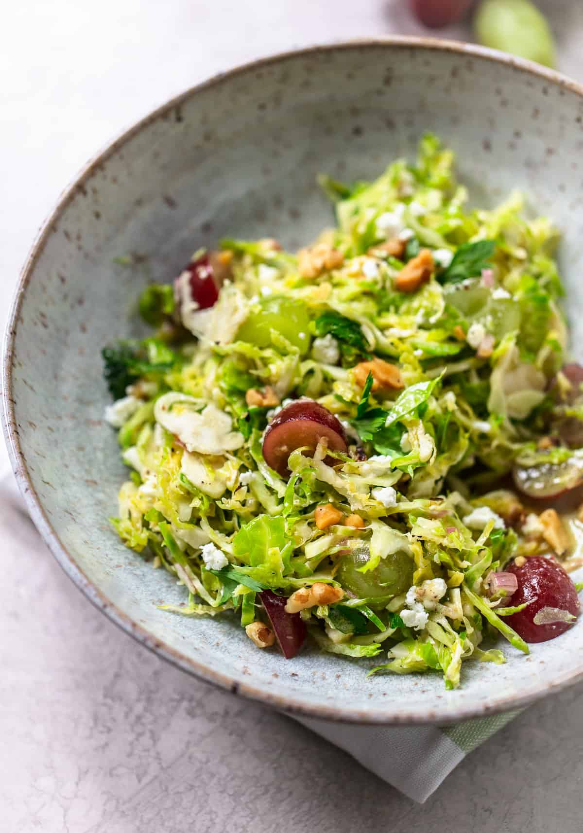 Shaved Brussels Sprouts Salad with Grapes, Feta and Walnuts