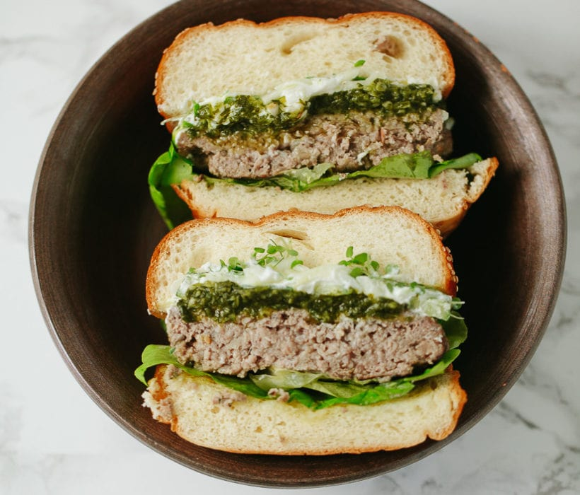 halved lamb burgers with shawarma spice and green sauce