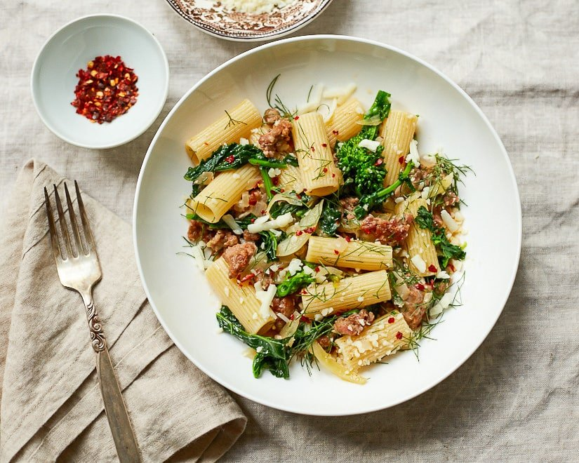 Broccoli Rabe Pasta with Italian Sausage and Fennel in a white bowl.