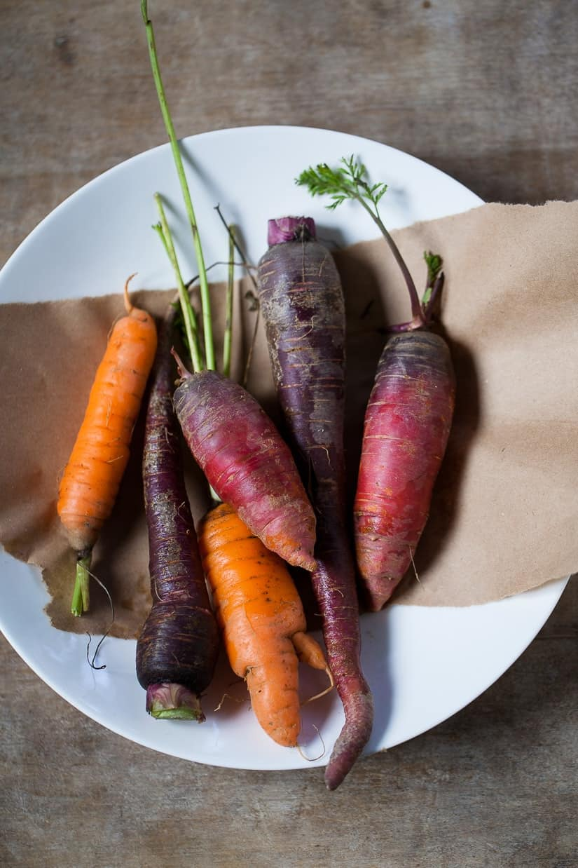 bunch of rainbow colored carrots