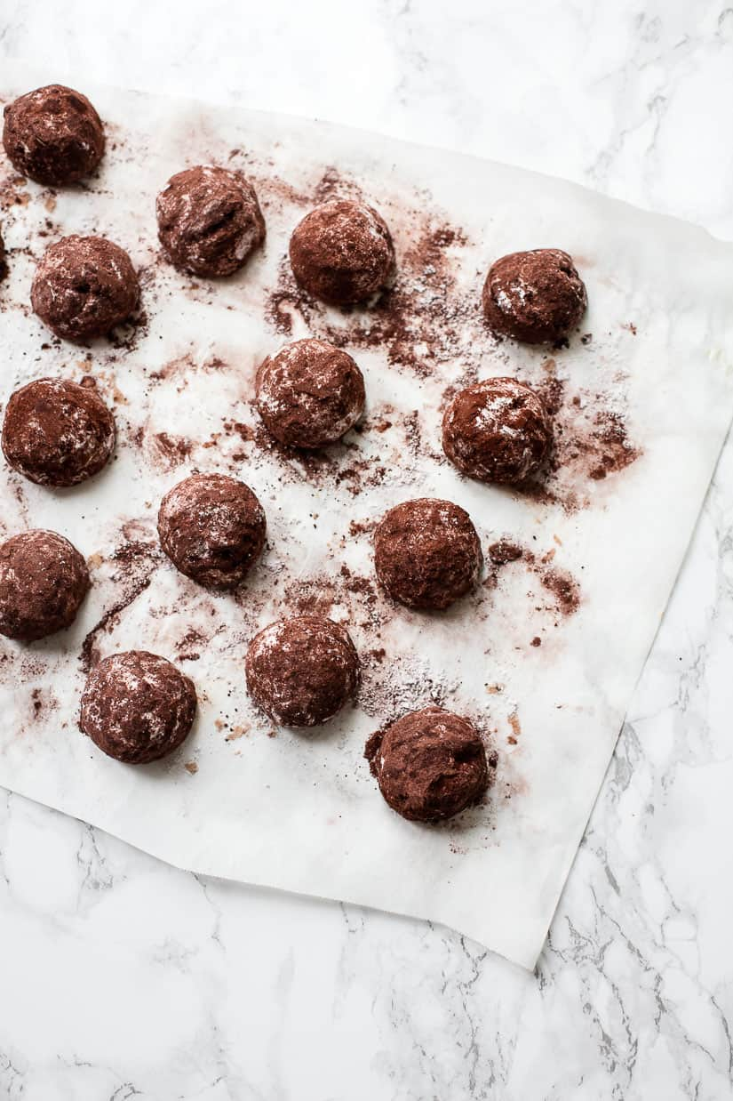 Hazelnut and Chocolate Snowball Cookies dusted with cocoa and powdered sugar