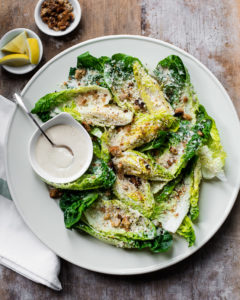 Tangy, creamy and lemony tahini caesar salad dressing with little gem romaine lettuce and baked olive oil breadcrumbs