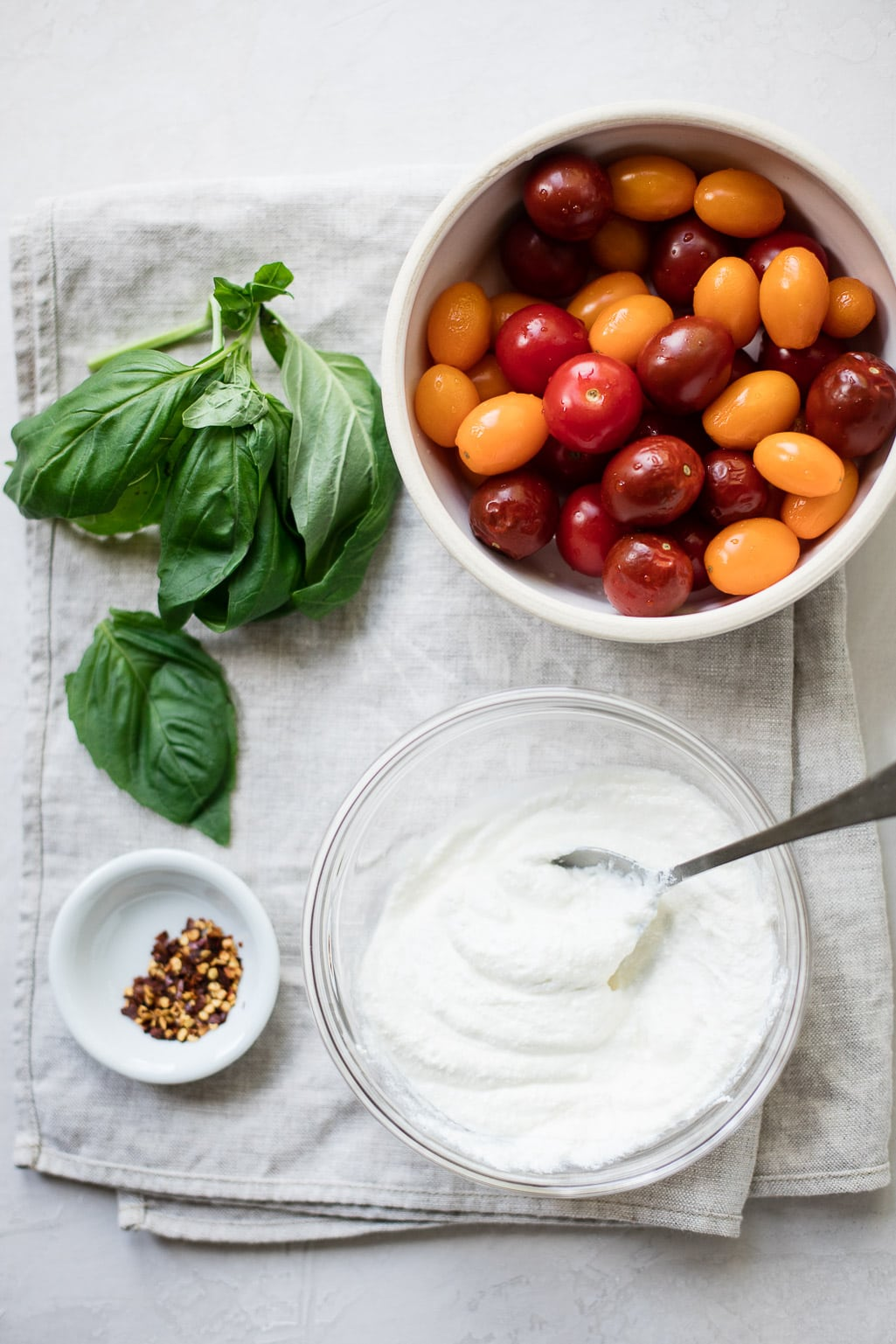 Cherry tomatoes, basil and fresh ricotta make a fast and delicious pasta sauce!