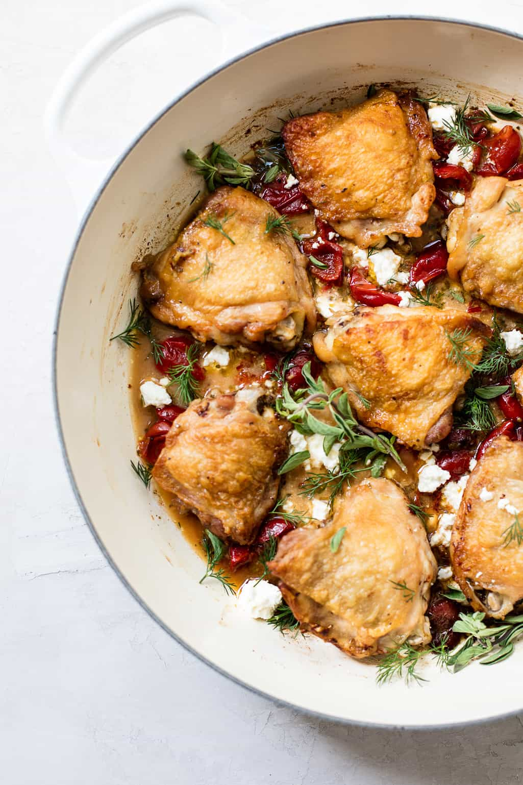 One-pan braised Greek chicken with feta cheese, oregano and sweet red peppers