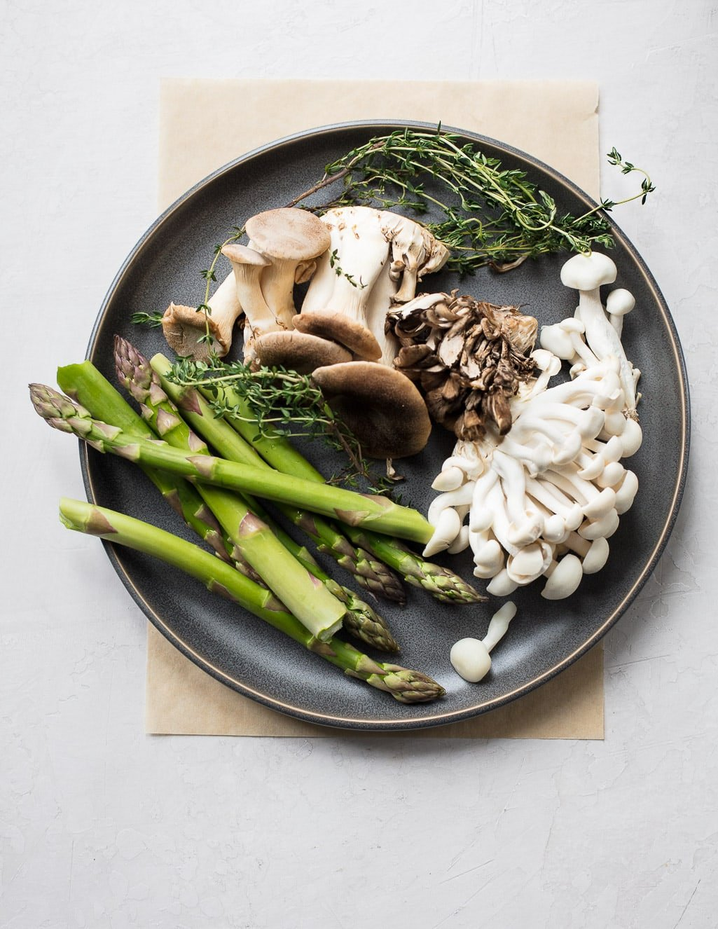 Fresh asparagus, wild mushrooms and thyme make a delicious spring pasta sauce