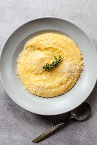 A bowl of creamy polenta with Parmesan cheees