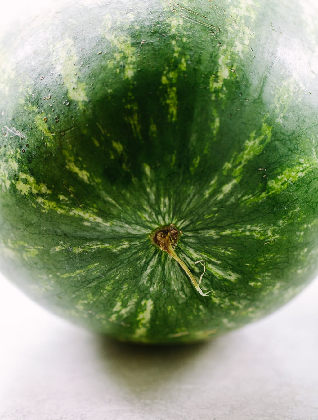 close up photo of a green seedless watermelon