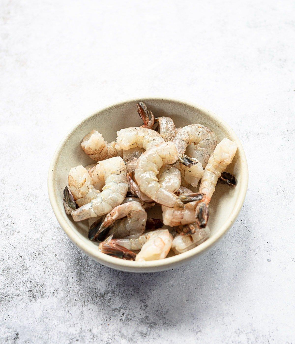 A bowl of raw peeled shrimp