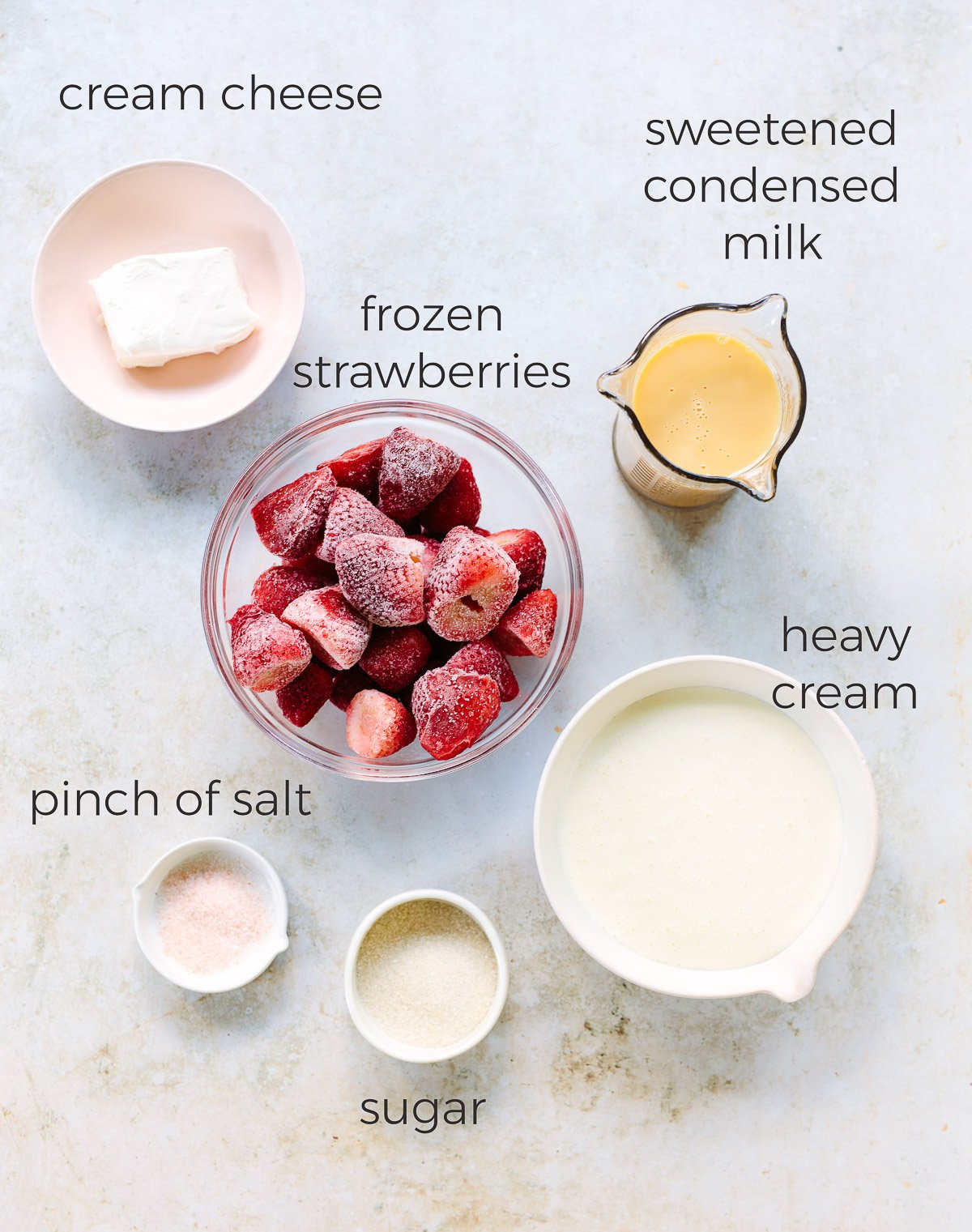 Ingredients for making homemade strawberry ice cream