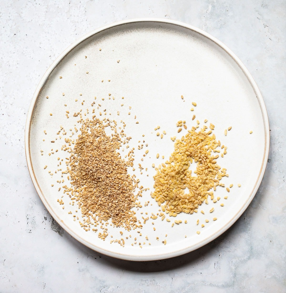 Bulgur wheat in coarse and extra-course grains on a plate for tabbouleh salad.